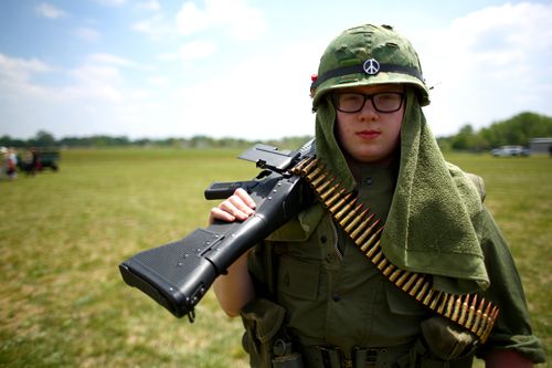 Reilly Fronczak of Schaumburg stands at the ready in Vietnam fatigues.