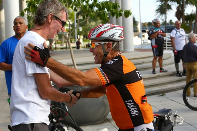 fl-clo-ride-of-silenceMichael Gale (right) greets fellow bicyclist Ray Strack before the Ride of Silence at Esplanade Park in Fort Lauderdale May 21, 2014. Strack is riding a bike during the silent procession for the first time since being hit by a car w