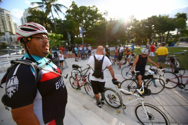 fl-clo-ride-of-silenceTed Rivera (left) looks on as cyclists gather at Esplanade Park in Fort Lauderdale during the Ride of Silence on May 21, 2014. The ceremony is a part of an annual event where cyclists take to the roads in a silent procession to hono