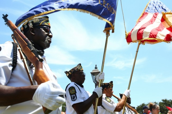 fl-memorial-ceremonyMembers of the American Legion Post 287 stand during the presentation of colors at the May Memories event in honor of Memorial Day at the historic Buter House in Deerfield Beach May 25, 2014.Joe Rondone / Correspondent