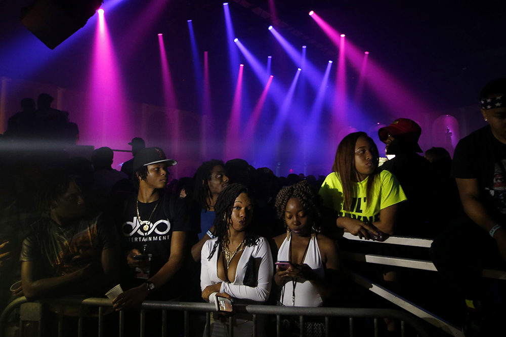 Fans wait for Lil Wayne's arrival at the Coliseum on Friday, March 20, 2015.